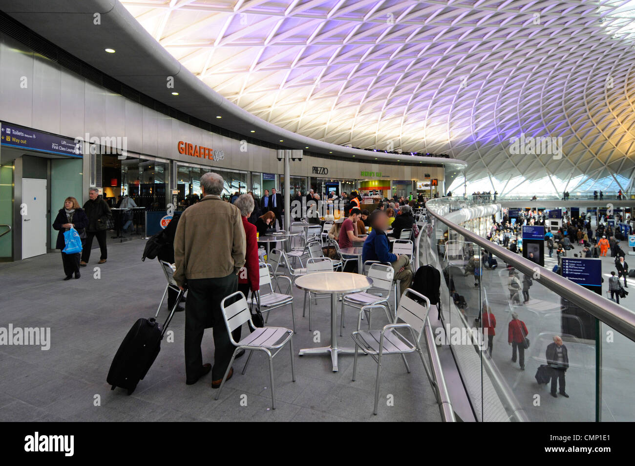 Kings Cross Railway Station cafe and eating facilities on mezzanine floor above main departure concourse - Stock Image