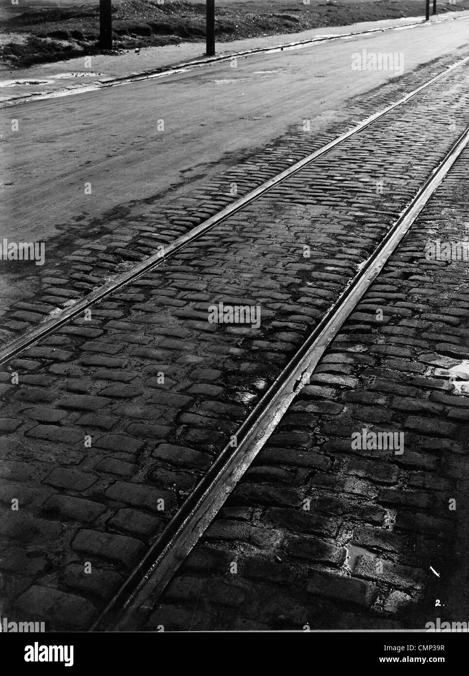 Tramlines, Willenhall Road, Wolverhampton, Early 20th cent. Tramlines showing some damage (foreground) on the partly Stock Photo