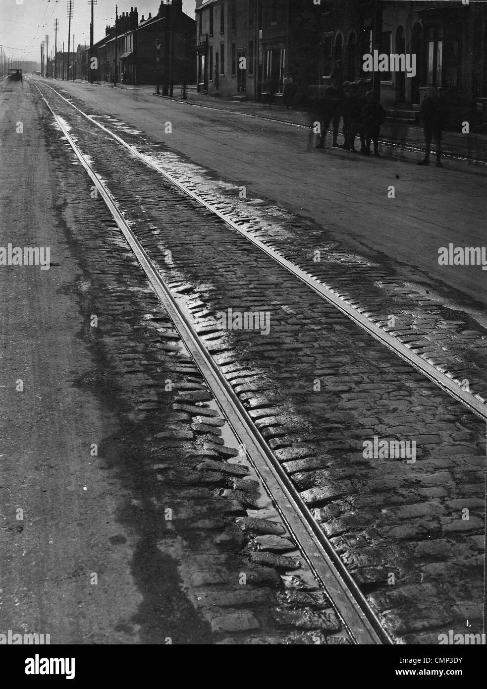 Tramlines, Willenhall Road, Wolverhampton, Early 20th cent. Tramlines on the partly cobbled Willenhall Road. The Stock Photo