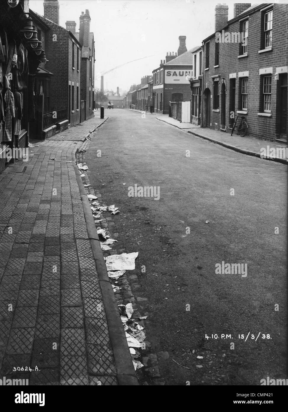 Drayton Street, Wolverhampton, 13954. A view of terraced houses. To the left (with the lamps) stands A & H. - Stock Image