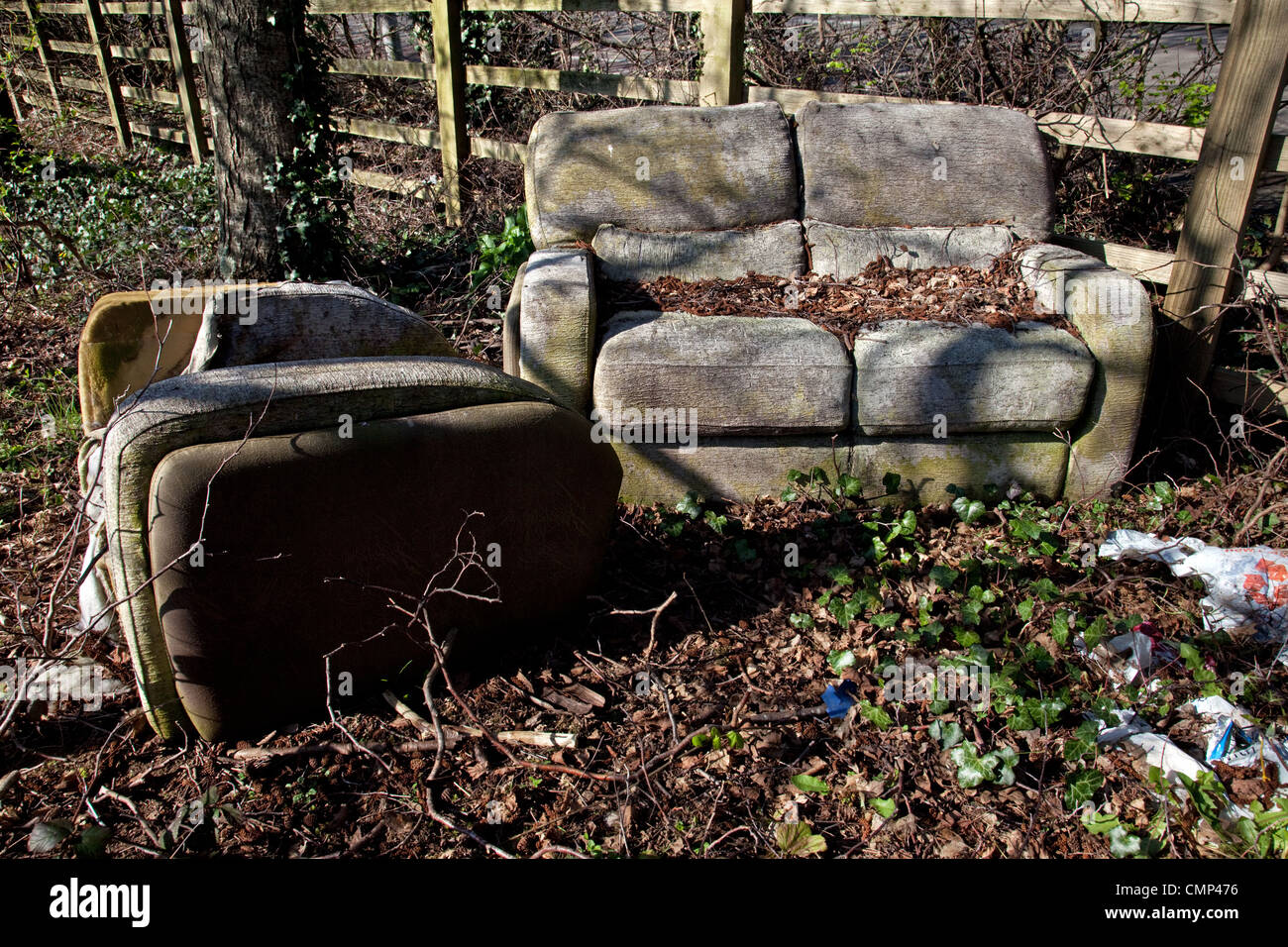 Old suite illegally dumped on a Devon roadside instead of using the local recycling and waste disposal facilities. - Stock Image
