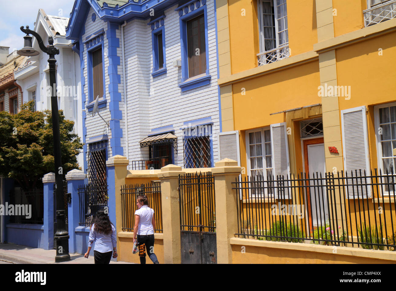 Santiago Chile Providencia Vina del Mar residential area neighborhood attached houses home wrought iron fence two - Stock Image