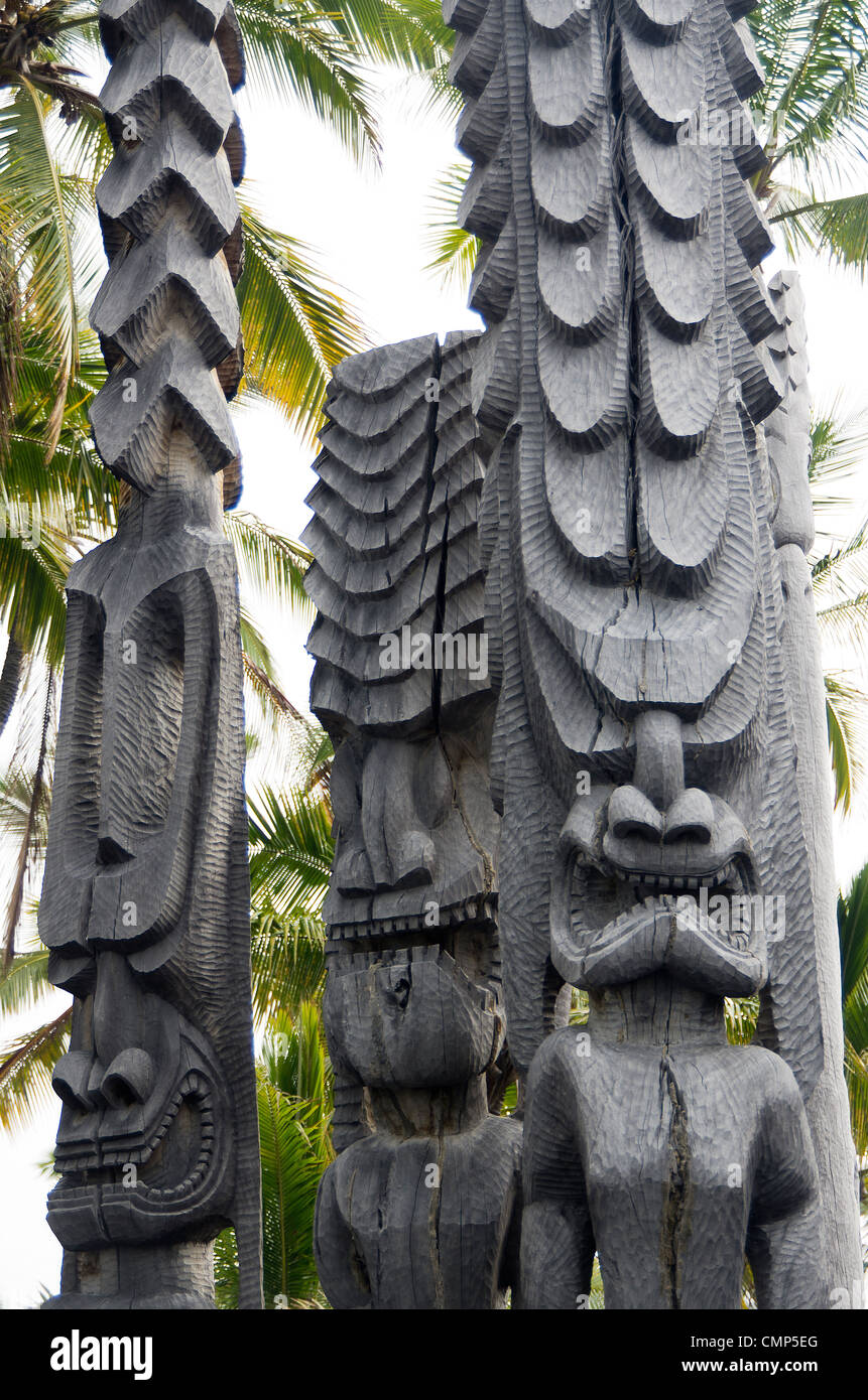 three tikis at the place of refuge, Big Island, Hawaii - Stock Image