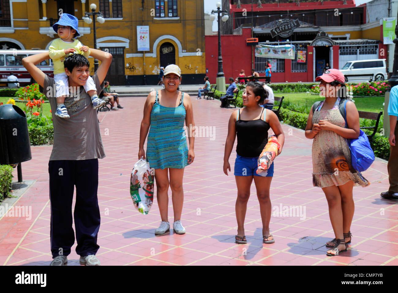 Lima peru barranco district parque municipal urban park open space promenade hispanic girl boy teen toddler