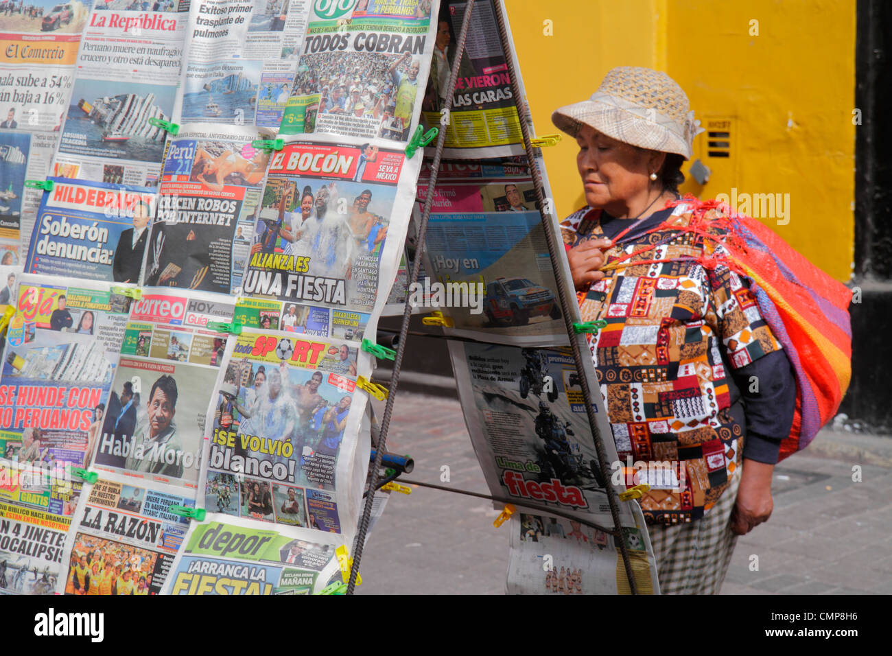 Lima Peru Barranco District Avenida Miguel Grau street scene newsstand newspaper periodical Spanish language headline - Stock Image