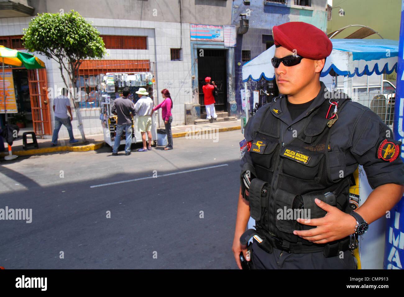 Lima Peru Surquillo Mercado de Surquillo street scene commercial district Hispanic national guard Policia Nacional - Stock Image