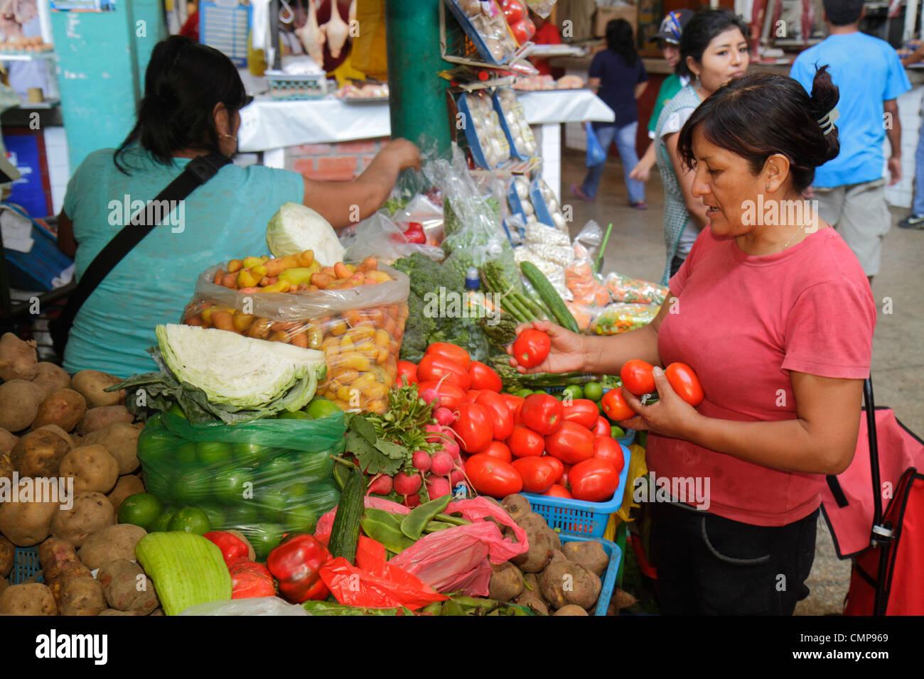 Lima Peru Surquillo Mercado de Surquillo market stall business shopping vendor produce vegetables potatoes radishes - Stock Image