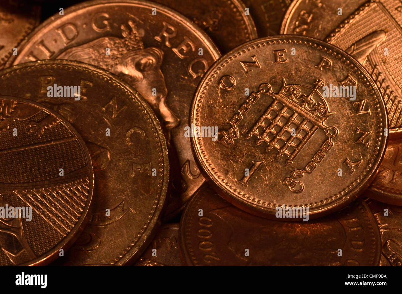 Close detail UK one and two pence coins. 1p and 2p pennies. - Stock Image