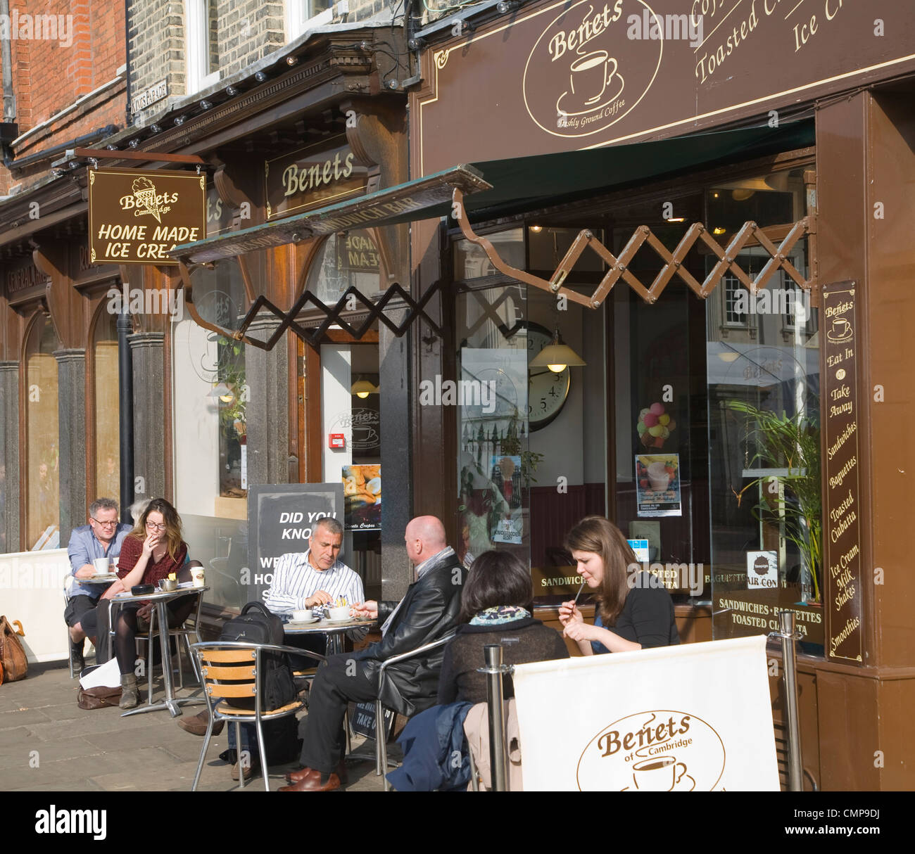 People Sitting At Tables Outside Benets Cafe Kings Parade Cambridge England