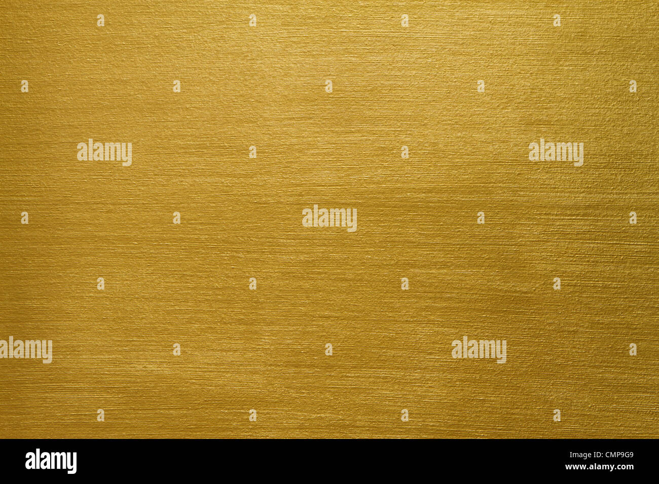 texture of a cement wall covered with gold paint with long strokes - Stock Image