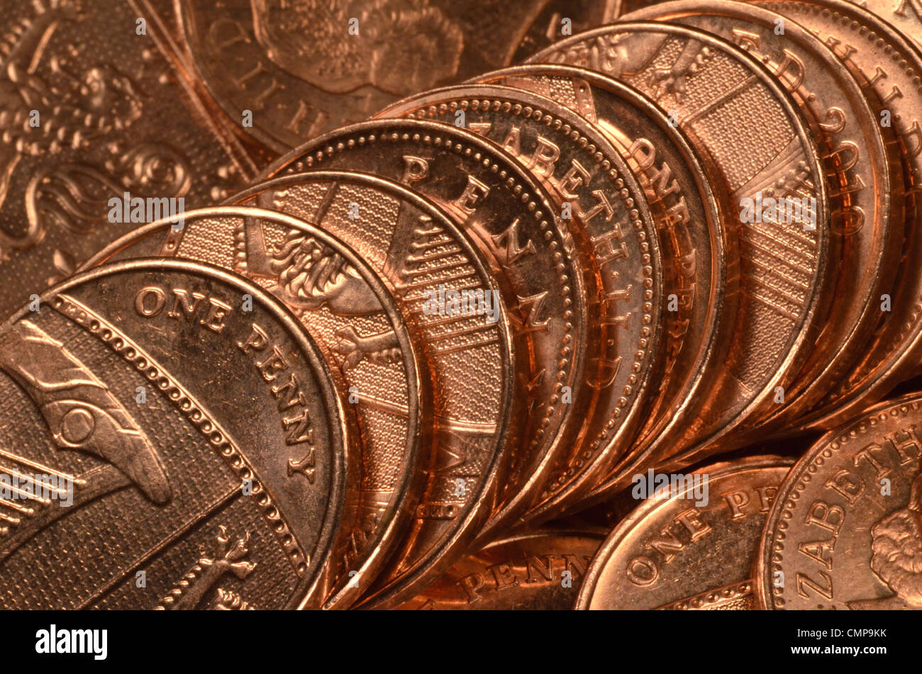 Close detail of UK one pence (1p) coin, single pennies. - Stock Image