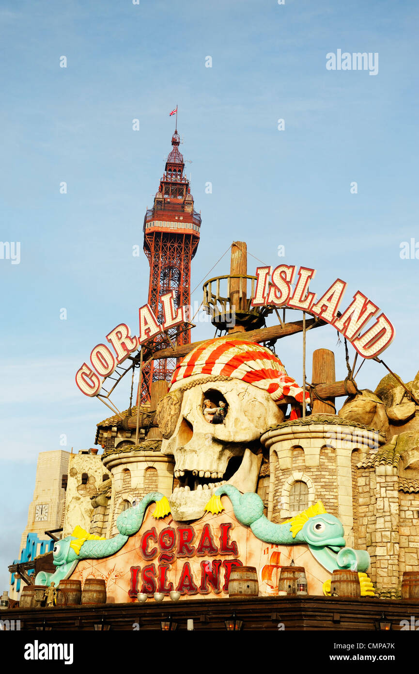 Blackpool Tower rises behind amusement park sign on the sea front at the seaside resort of Blackpool, Lancashire, - Stock Image