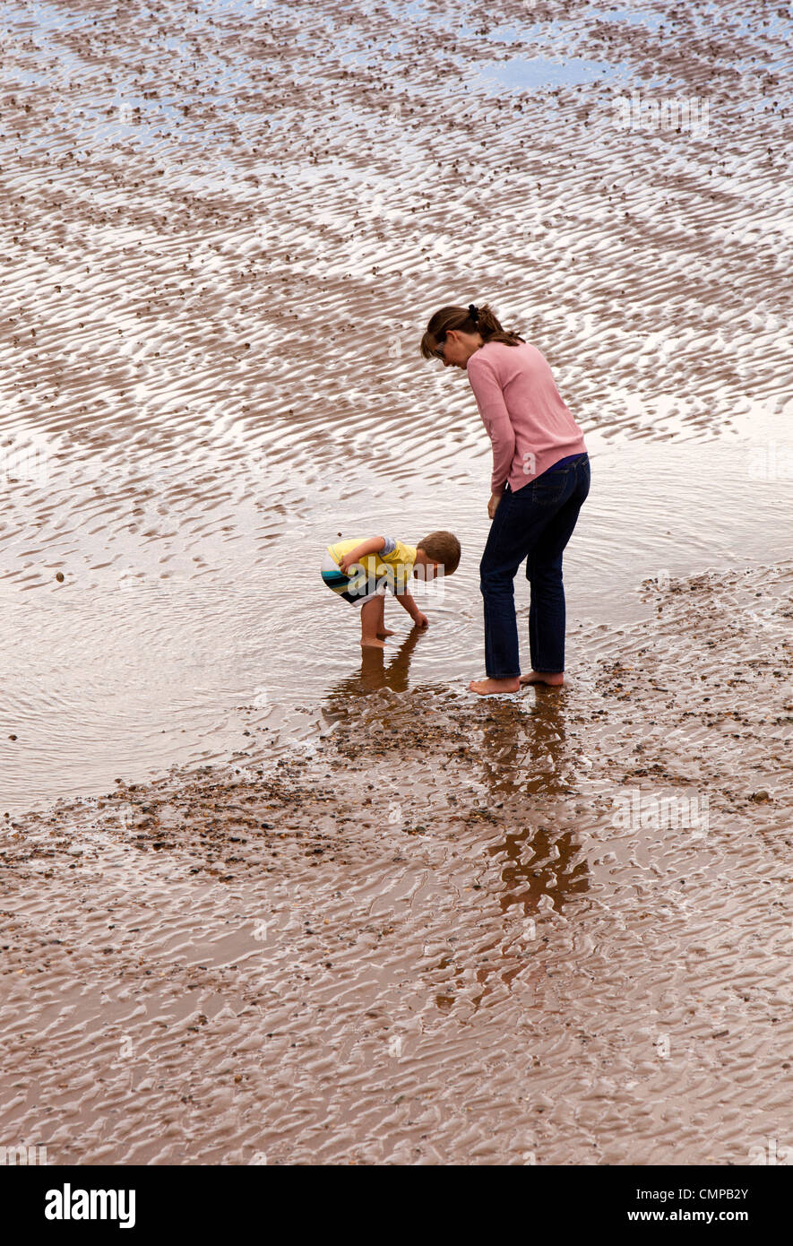 UK, England, Lincolnshire, Cleethorpes, mother and child playing in shallows at low tide Stock Photo