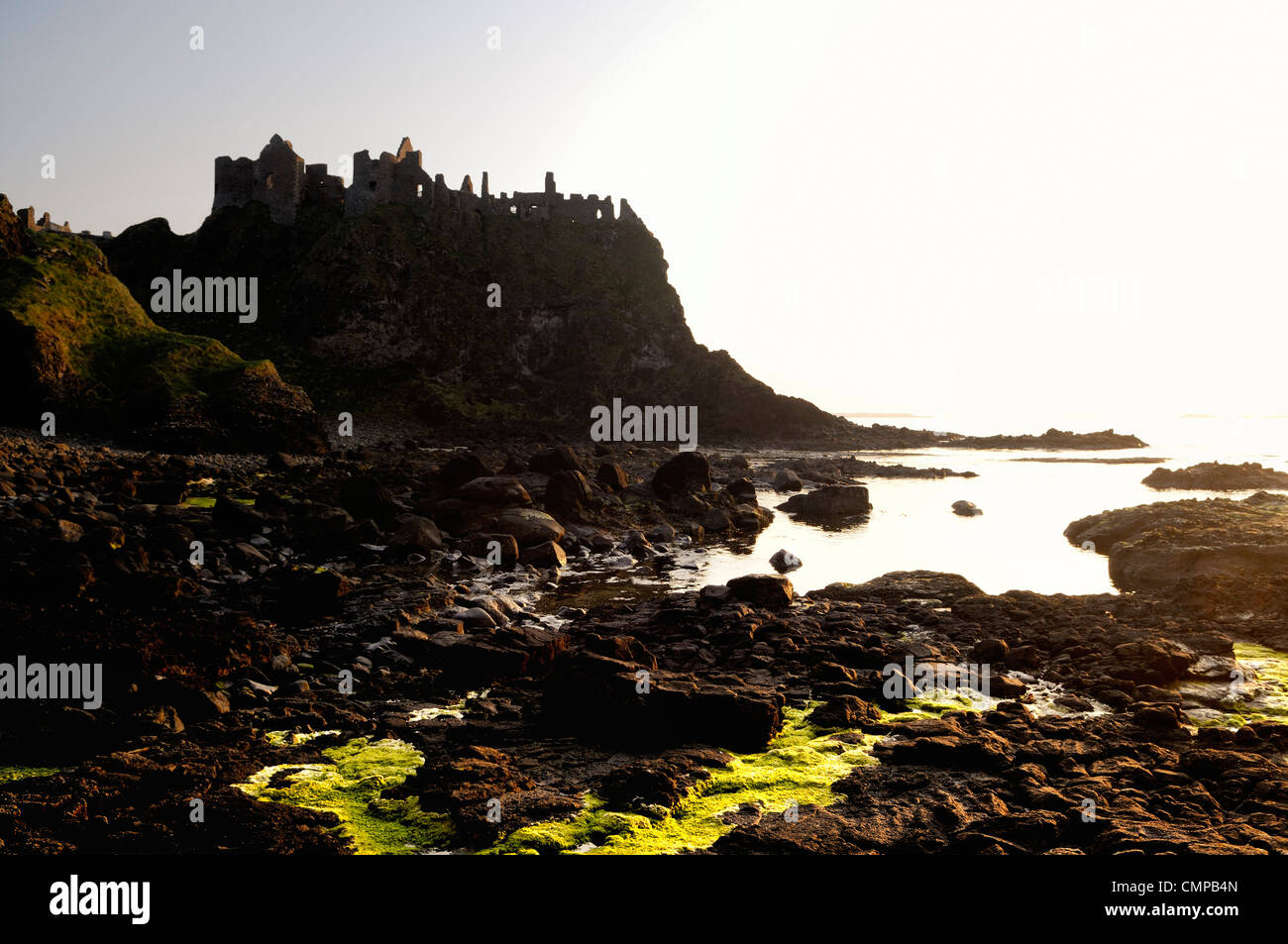Dunluce Castle, mediaeval ruin between Portrush and Bushmills. North Antrim Coast Road, County Antrim, Northern - Stock Image
