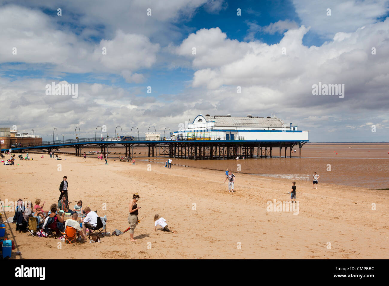 UK, England, Lincolnshire, Cleethorpes, visitors relaxing on beach in summer sunshine - Stock Image