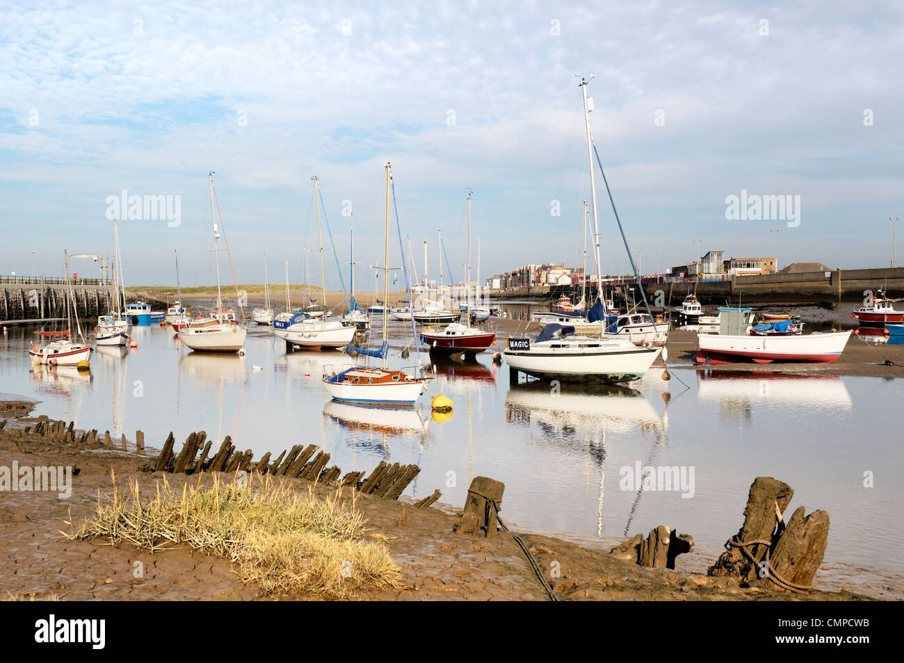 Sailing dinghies and leisure boats on the estuary of the River Clywd at the seaside resort of Rhyl, Denbighshire, - Stock Image