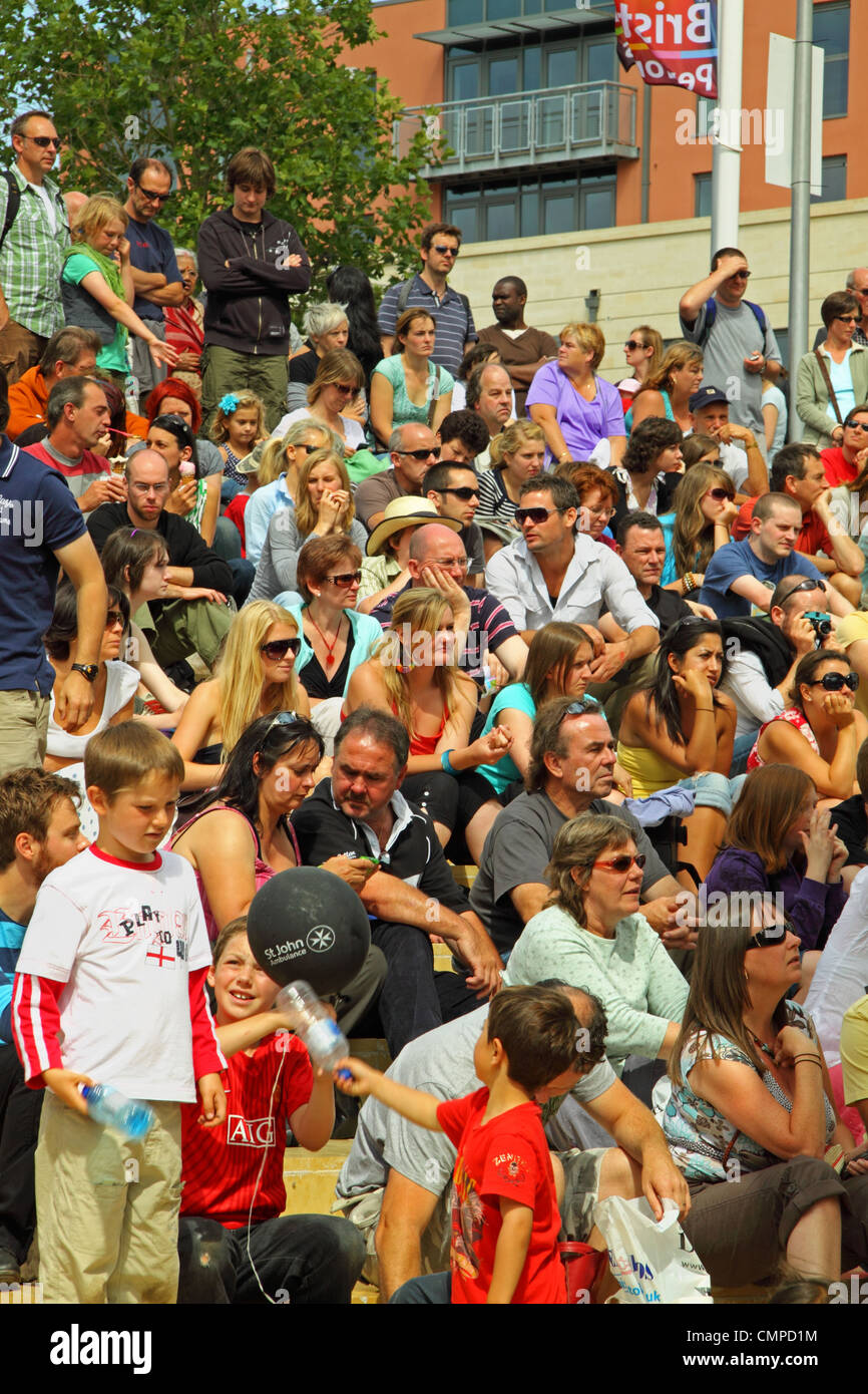 Audience beside the Cascade Steps stage at the Bristol Harbour Festival waiting patiently between acts - Stock Image