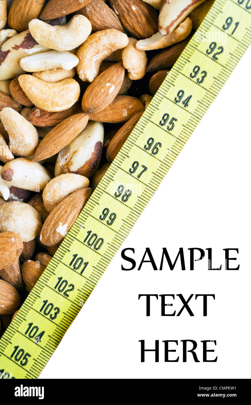 Background of mixed nuts isolated on white - Stock Image