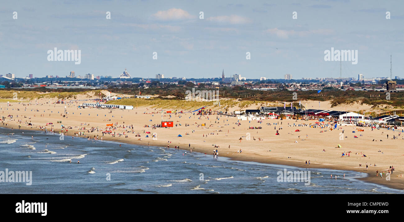 View to the beach from the seaside on a sunny day - Stock Image