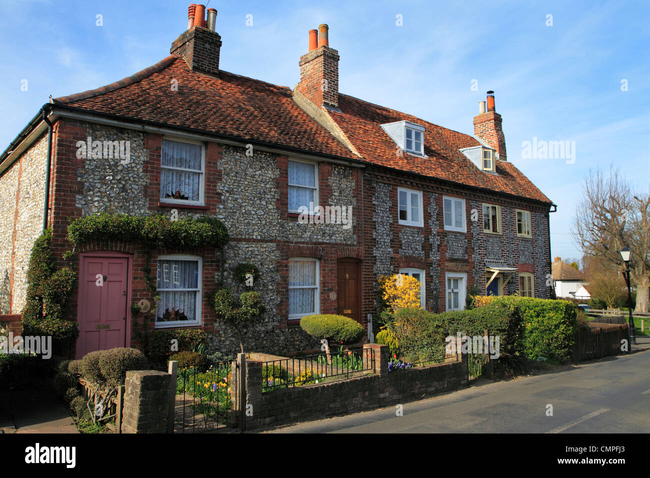 Row of traditional brick and flint cottages, Downe, Kent UK - Stock Image