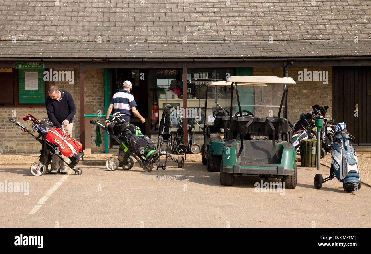 Golfers preparing their trolleys outside the golf shop, Newmarket Golf Club, Suffolk UK - Stock Image