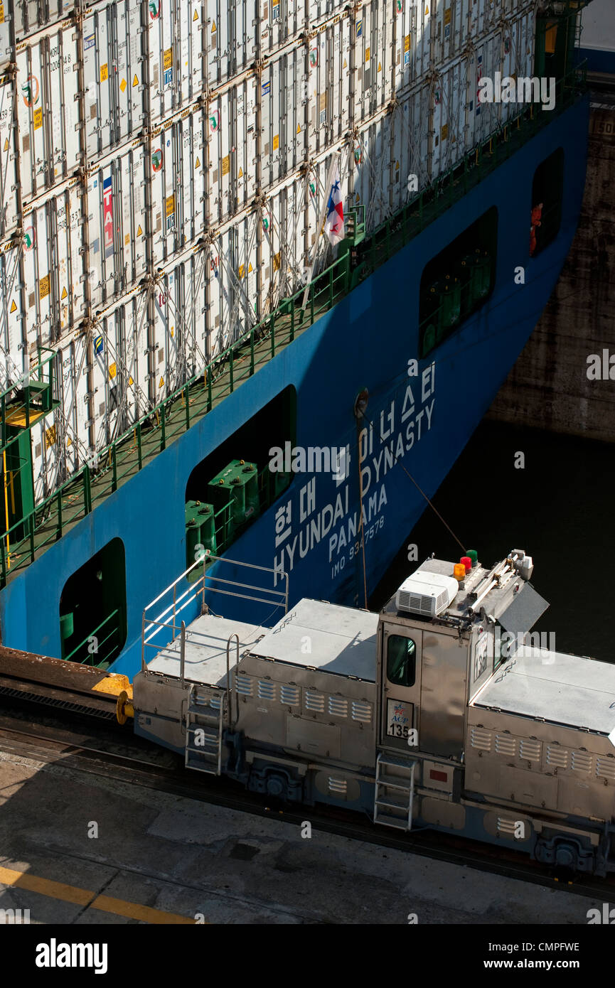 Containers cargo ship at Miraflores Locks. Panama Canal - Stock Image