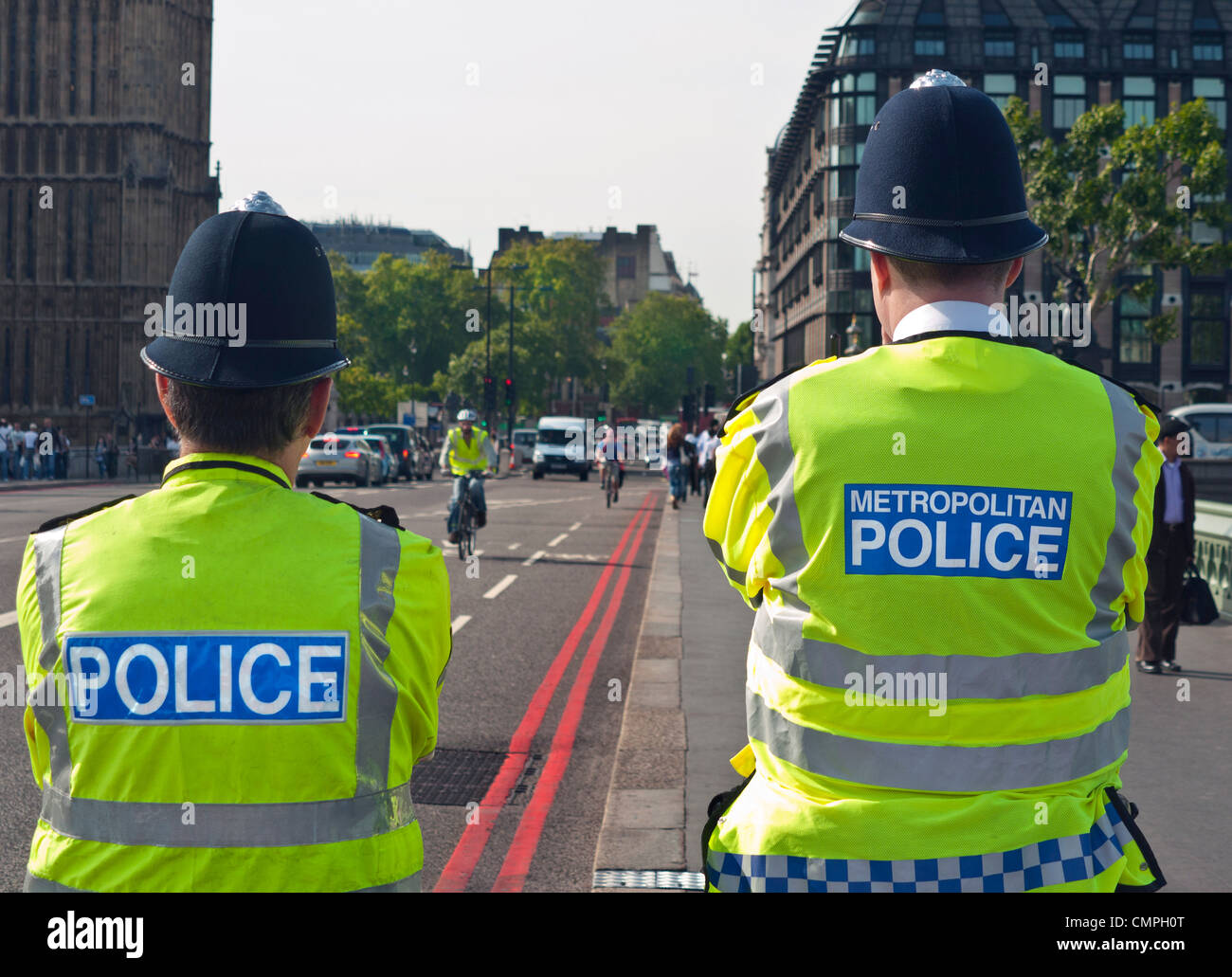 LONDON Metropolitan Police officers on duty at Westminster Bridge  Houses of Parliament London UK - Stock Image