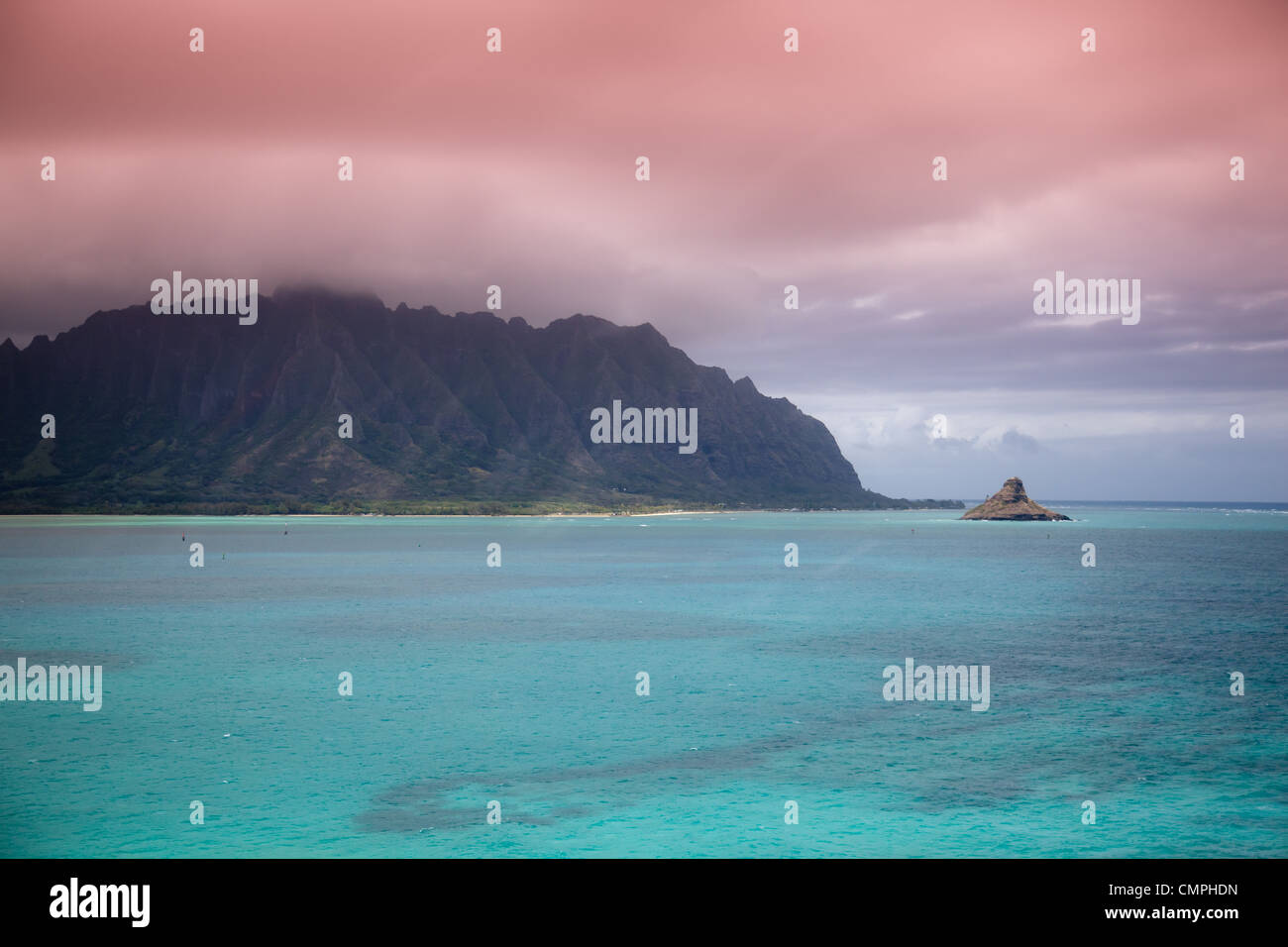Colorful sky over Kaneohe Bay, Oahu, Hawaii with Chinaman's Hat island to the left. - Stock Image