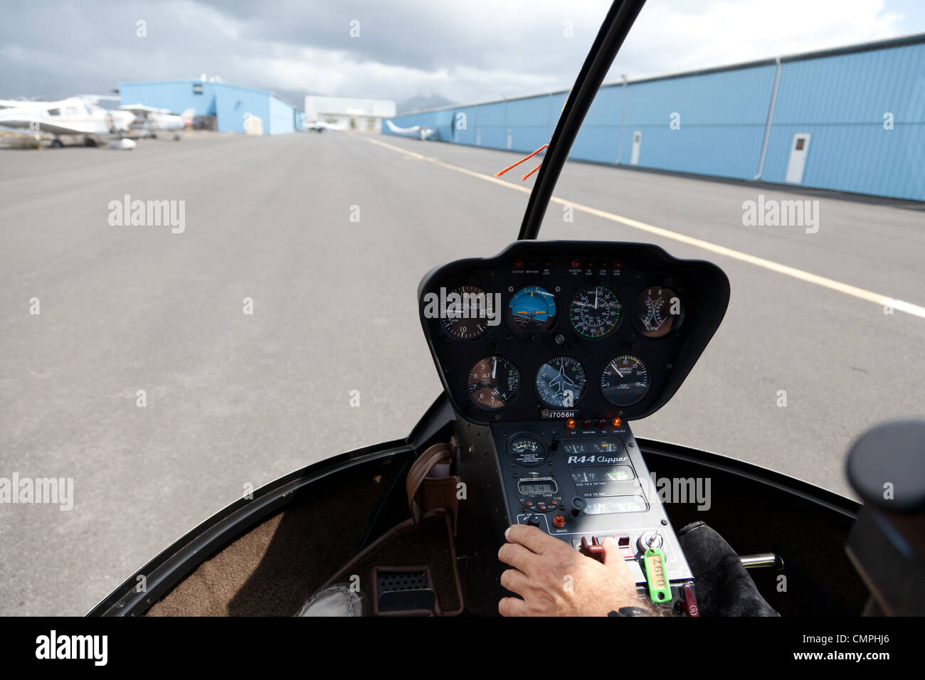 Interior or Robinson R-22 helicopter on runway - Stock Image