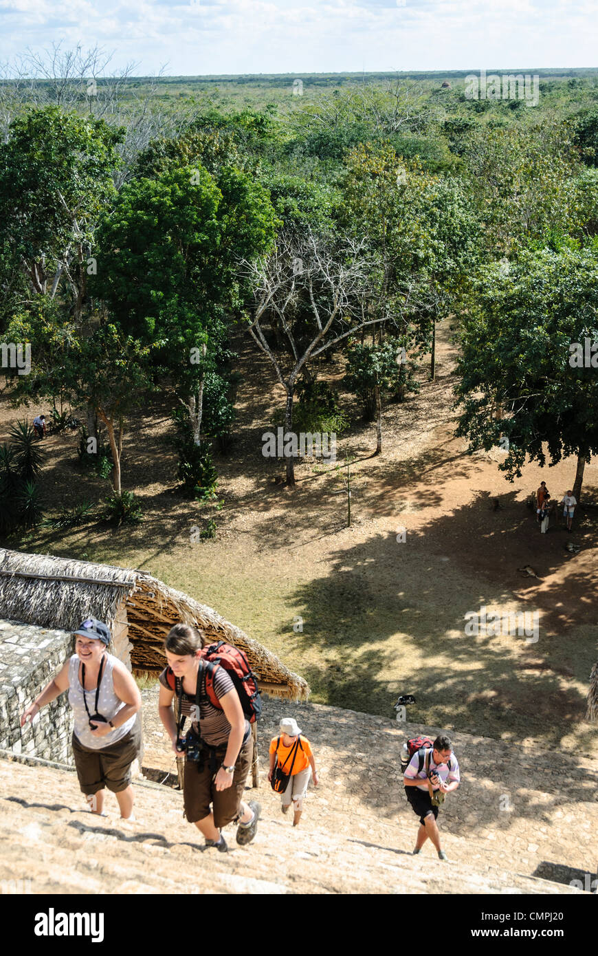 Tourists climb the steps of the Acropolis at Ek'Balam, one of the Mayan civilization ruins on Mexico's Yucatan - Stock Image