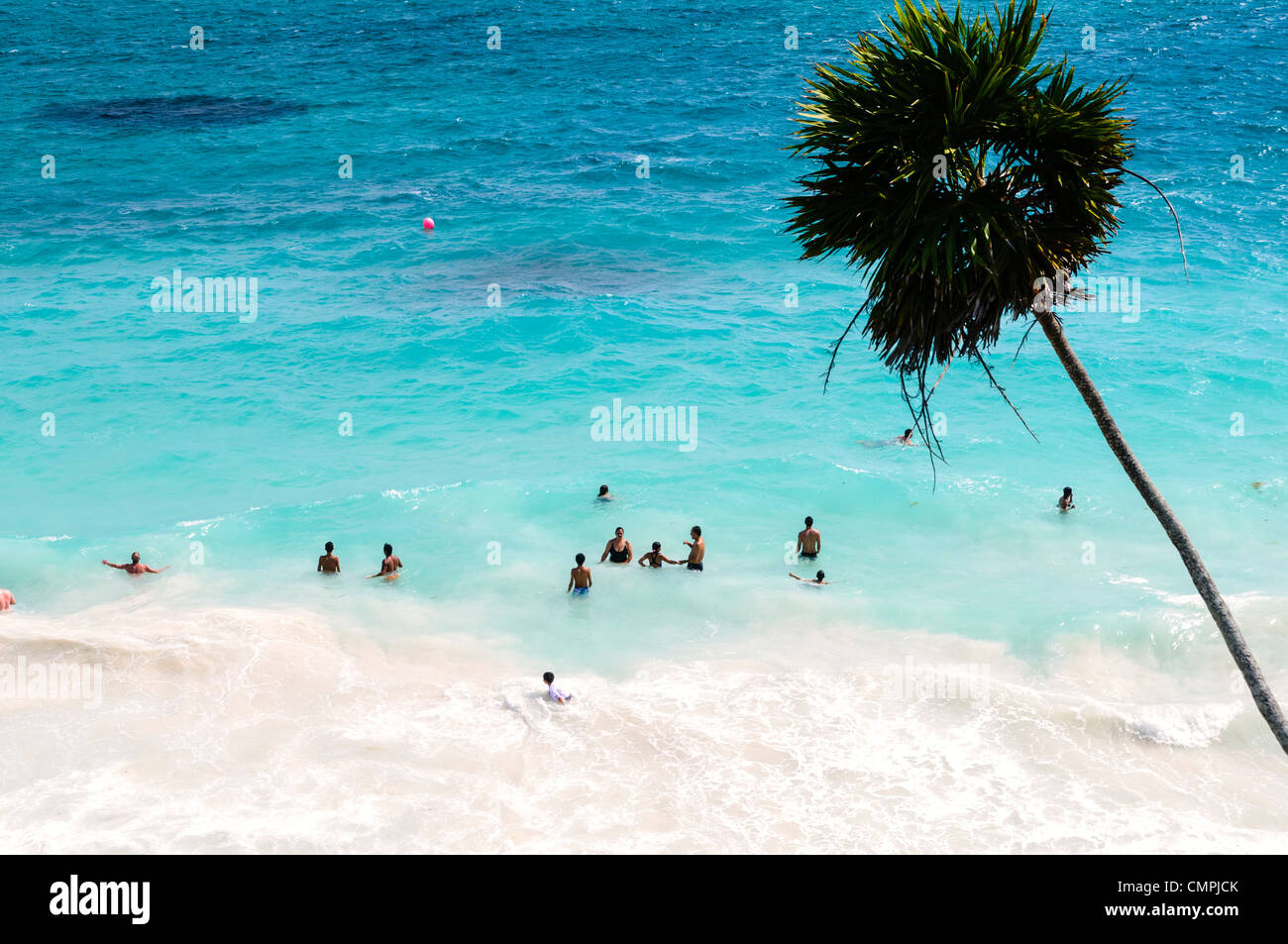 TULUM, Mexico - People swimming in the Caribbean Sea from one of the beautiful beaches next to the Maya civilizations - Stock Image