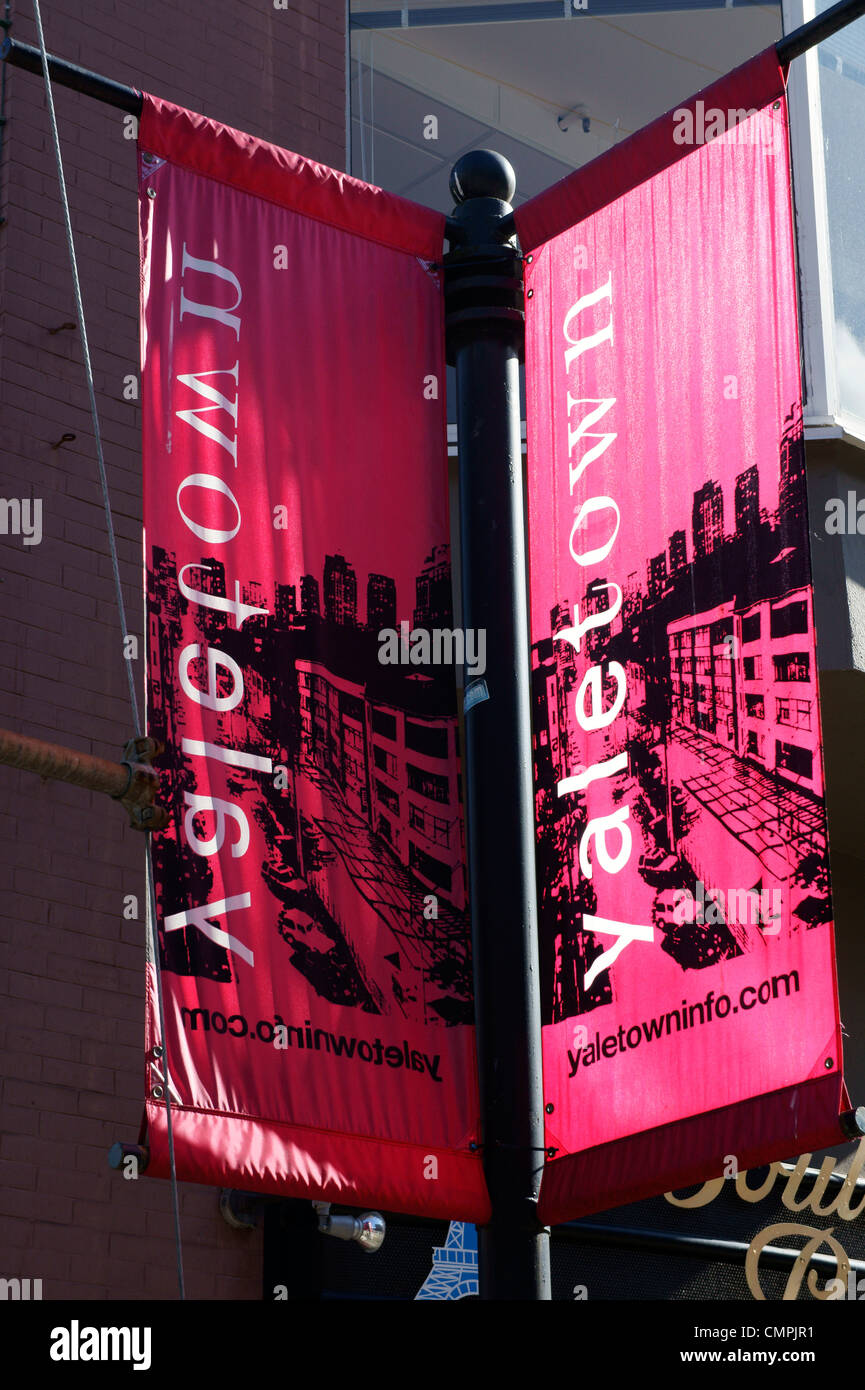 Banners on a post in Yaletown, Vancouver, British Columbia, Canada - Stock Image