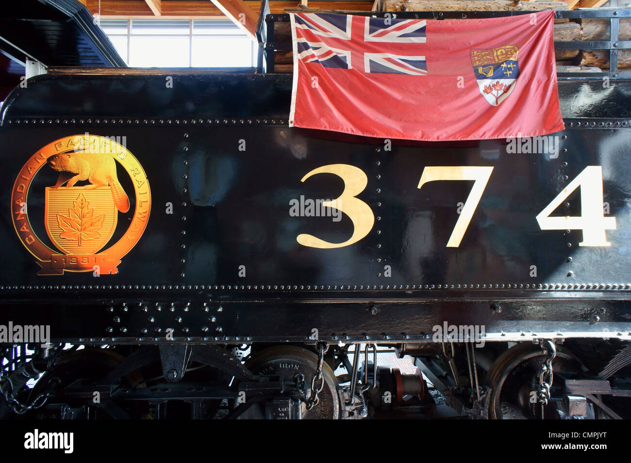 Red Ensign flag on the side of restored CPR Engine 374 at the Roundhouse in Yaletown, Vancouver, British Columbia, Stock Photo
