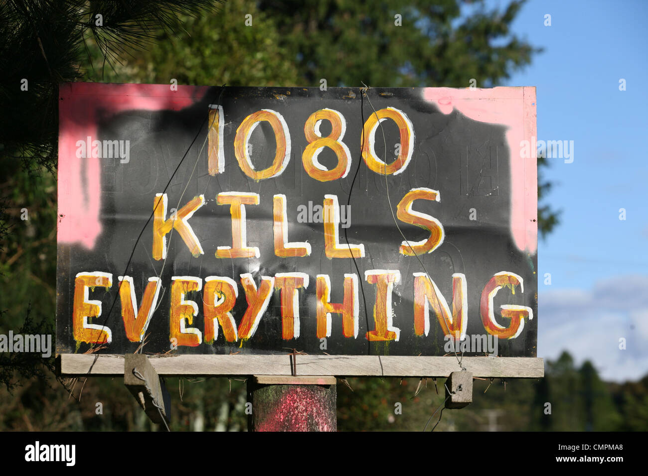 Political sign on roadside against the use of 1080 poison to kill pests such as possum in the New Zealand forest. - Stock Image