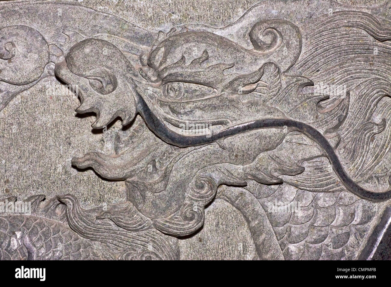 Dragon carve on wall expressing power and status in ancient China. - Stock Image