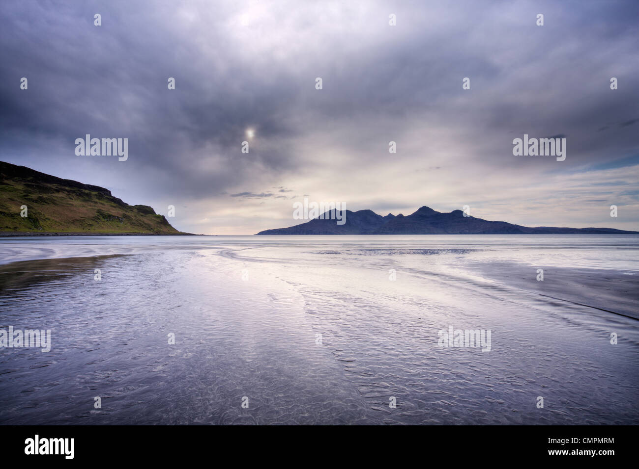 Early evening view towards Rum from the Bay of Laig on the Isle of Eigg, Hebrides, Scotland, United Kingdom, Europe - Stock Image
