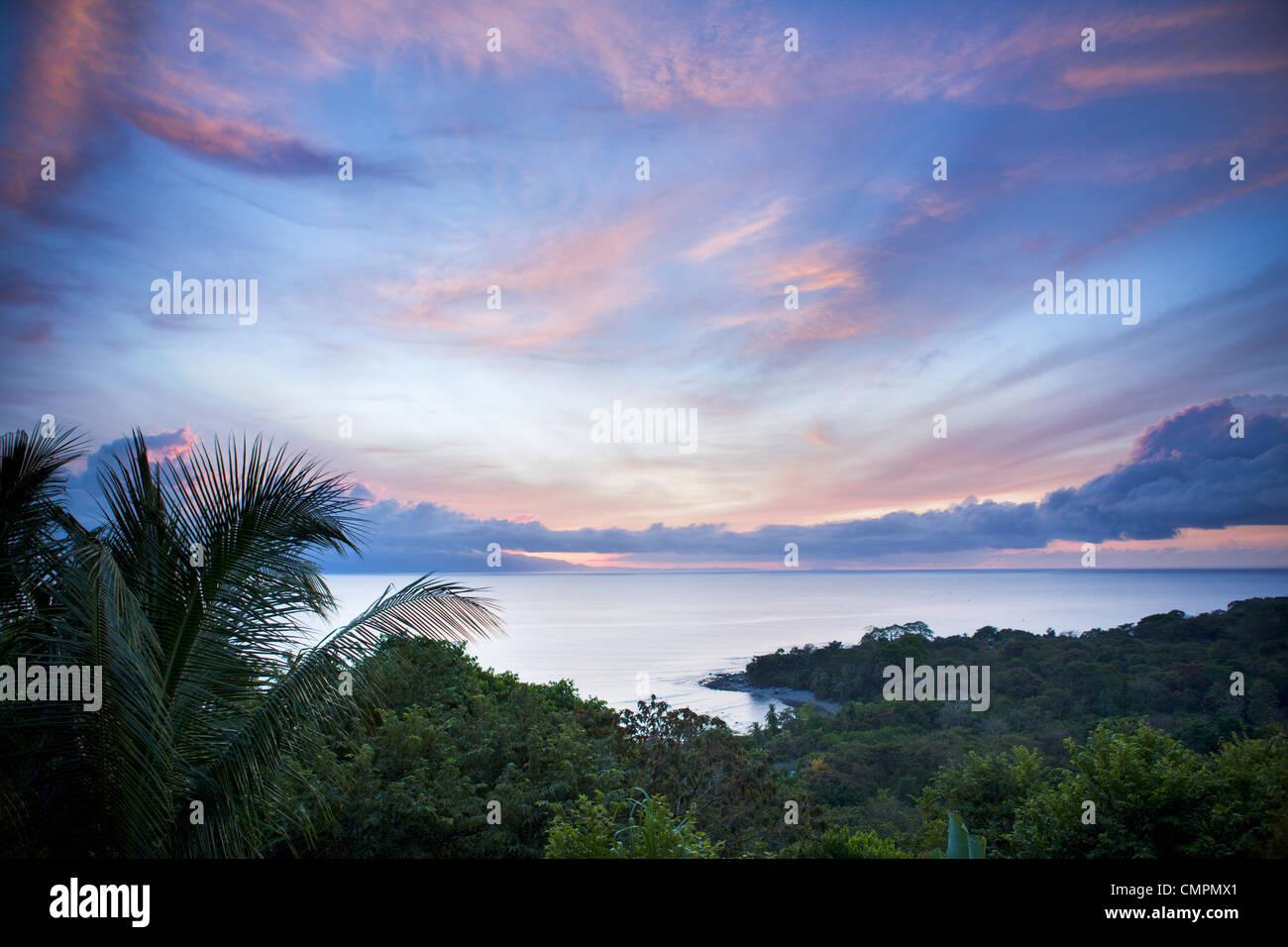 Sunrise in the jungle at Lapa Rios nature reserve on the Osa Peninsula, Costa Rica, Central America - Stock Image