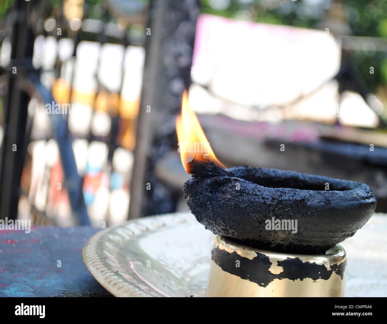 earthen lamp lit at guruvayoor temple, kerala - Stock Image