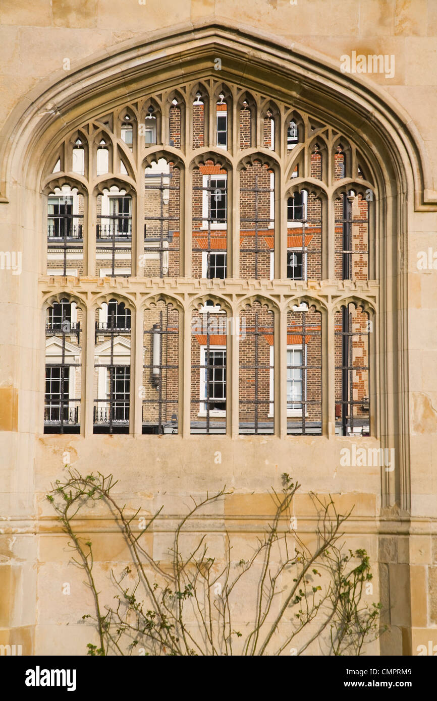Buildings in King's Parade glimpsed from King's College, Cambridge, England - Stock Image