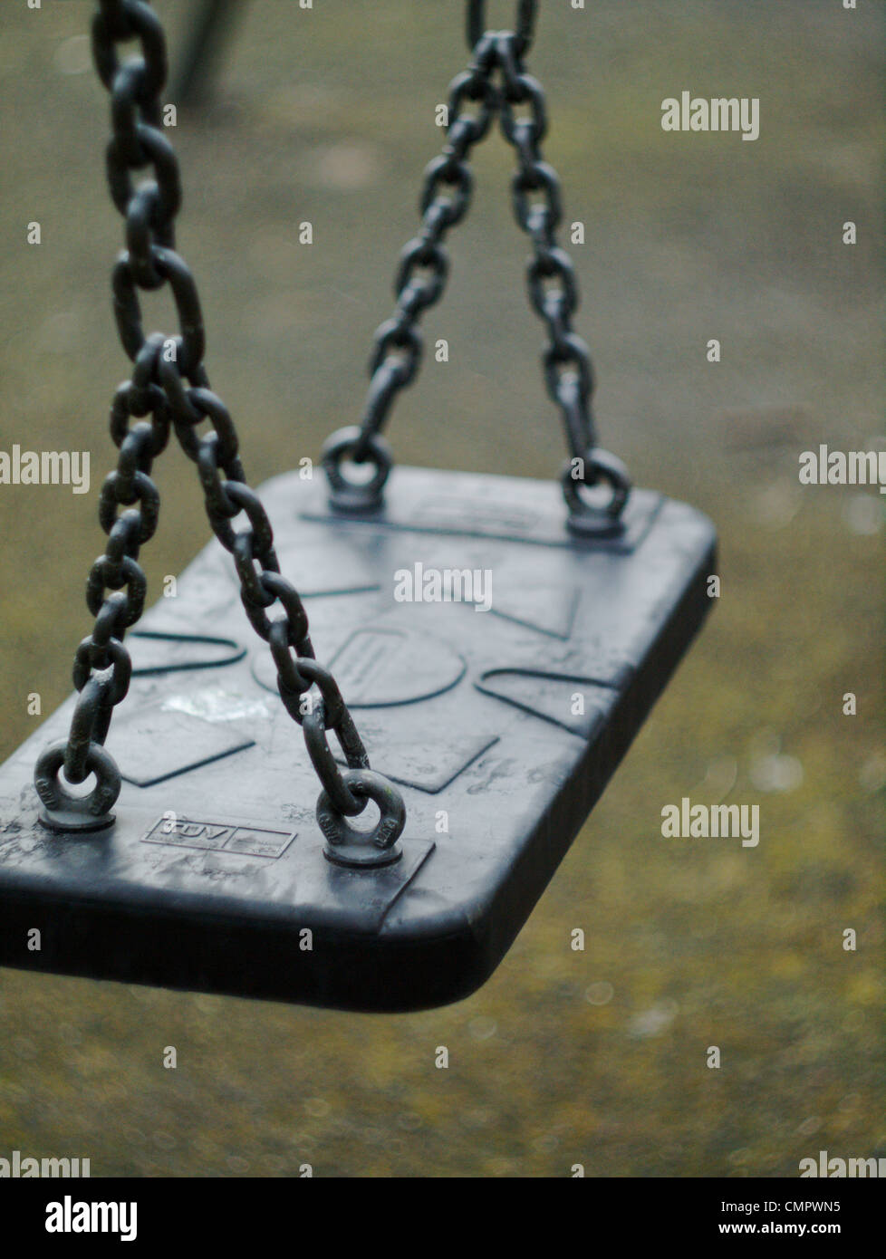 child`s swing seat in playground close up - Stock Image