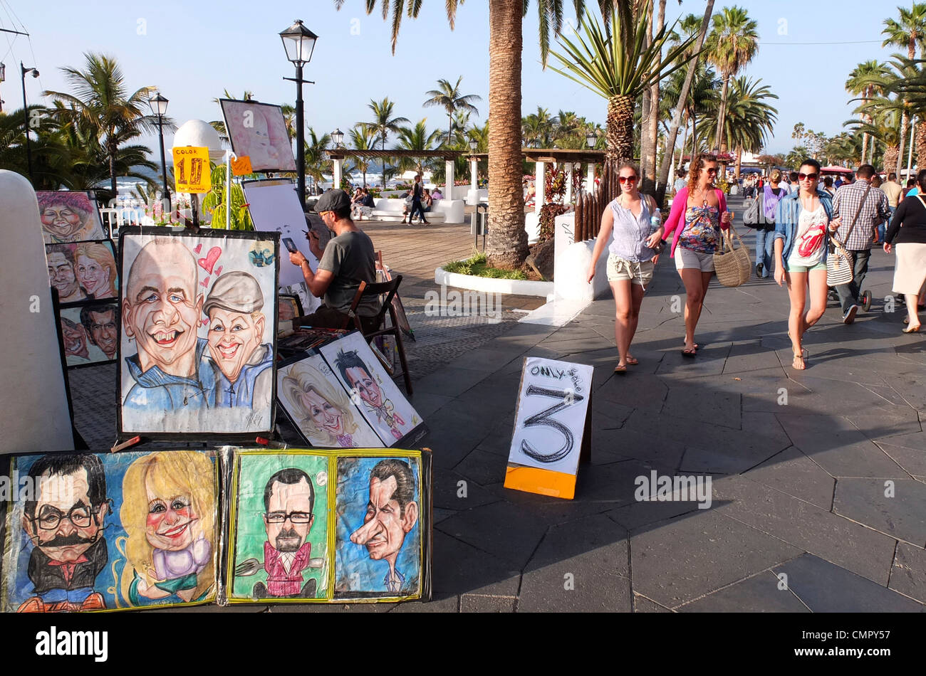 a street artist  drawing  caricatures - Stock Image