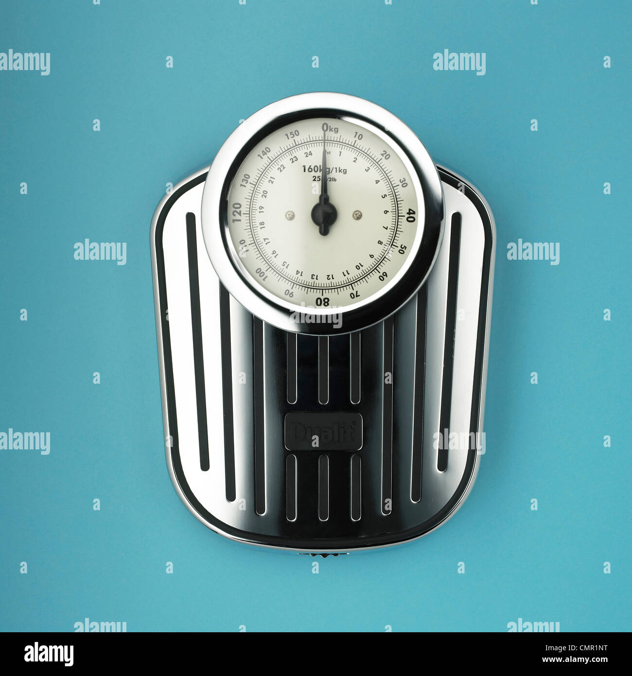 One stainless steel scales blue background - Stock Image
