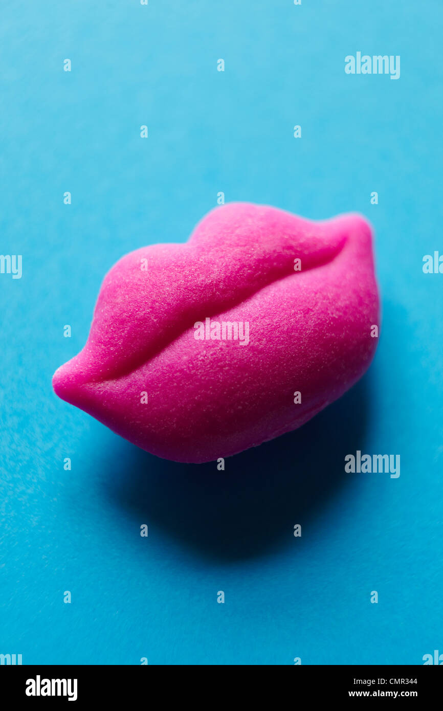 Still Life Of Luscious Pair Of Pink Lips Against Blue Background - Stock Image