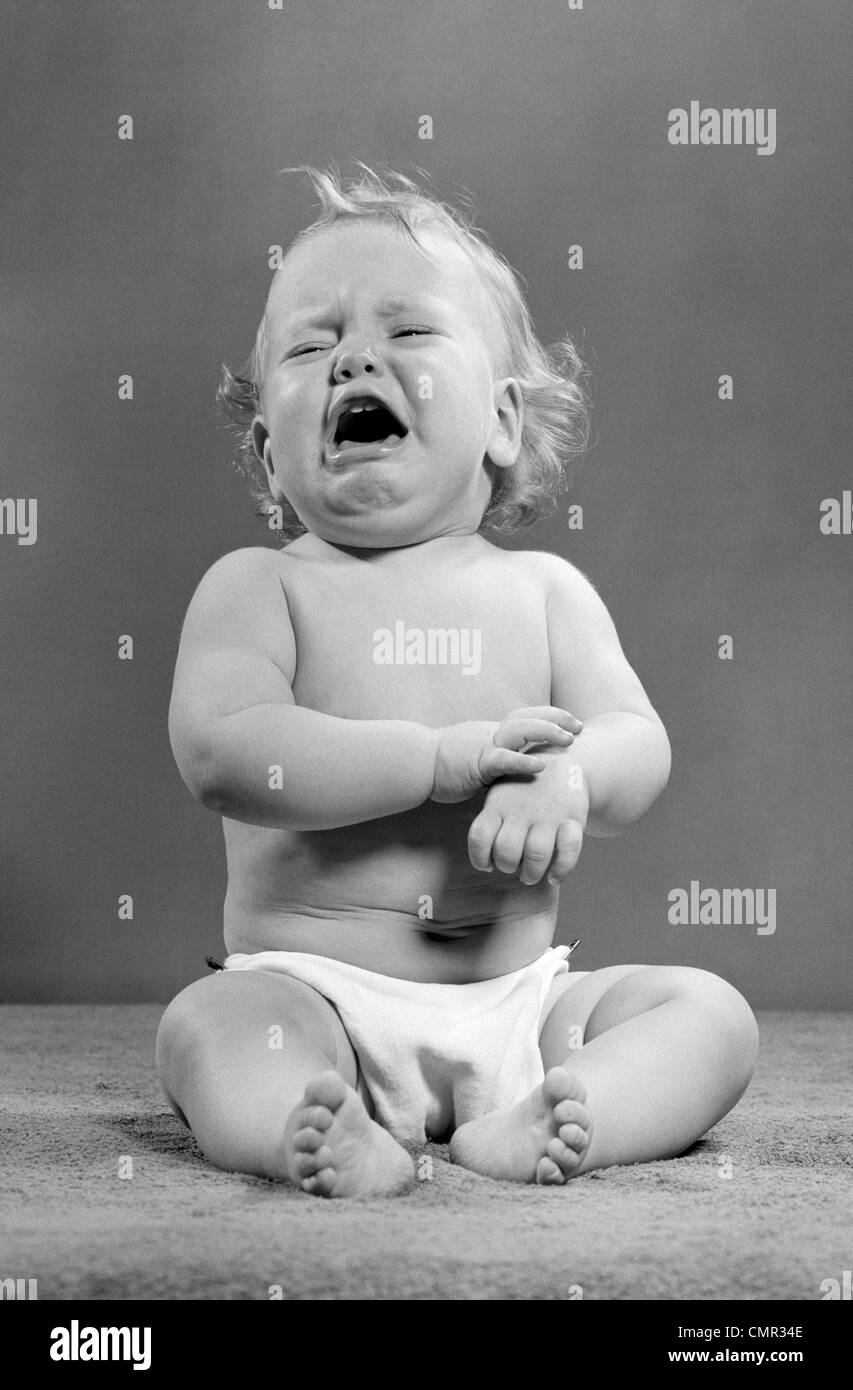 1940s 1950s CRYING BABY WEARING DIAPER - Stock Image
