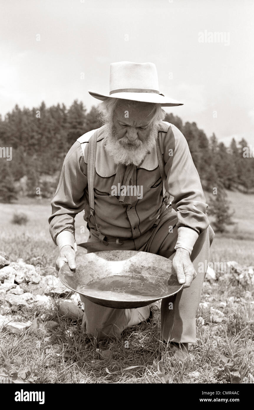 1950s MALE PROSPECTOR PANNING FOR GOLD Stock Photo