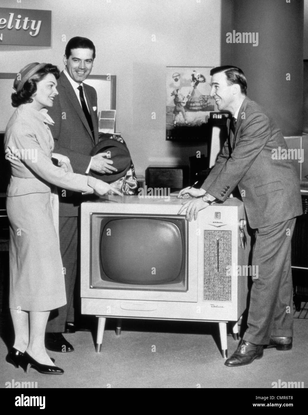 1950s 1960s Couple Buying New Console Television From