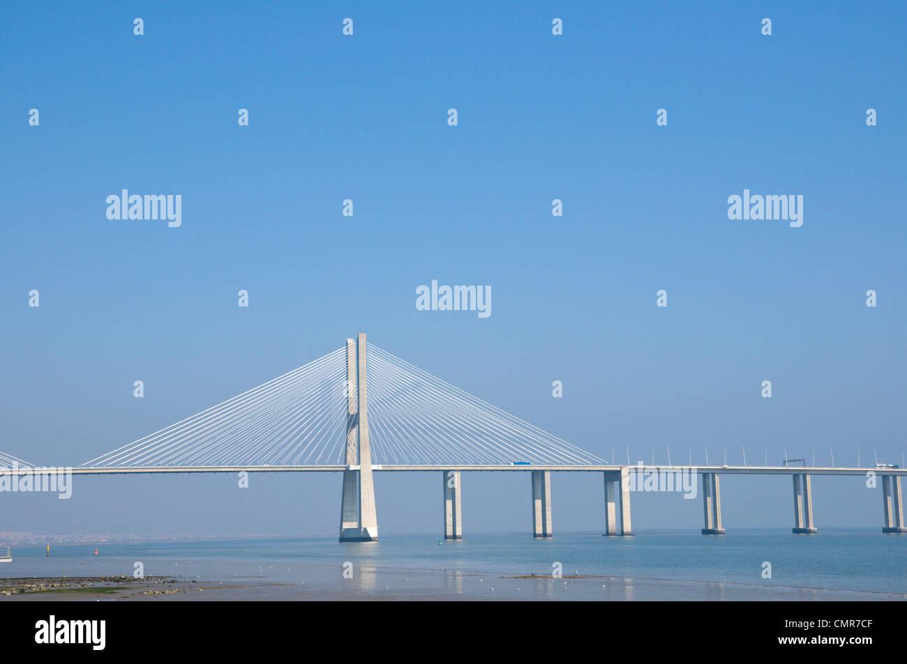 Ponte Vasco de Gama bridge (1992) by Armando Rito crossing river Tejo Lisbon Portugal Europe - Stock Image