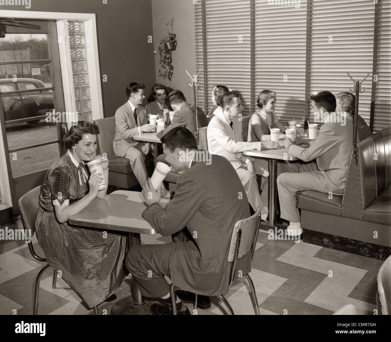 Exceptional 1950s MALT SHOP INTERIOR WITH TEENS AT BOOTHS DRINKING FROM DIXIE CUPS