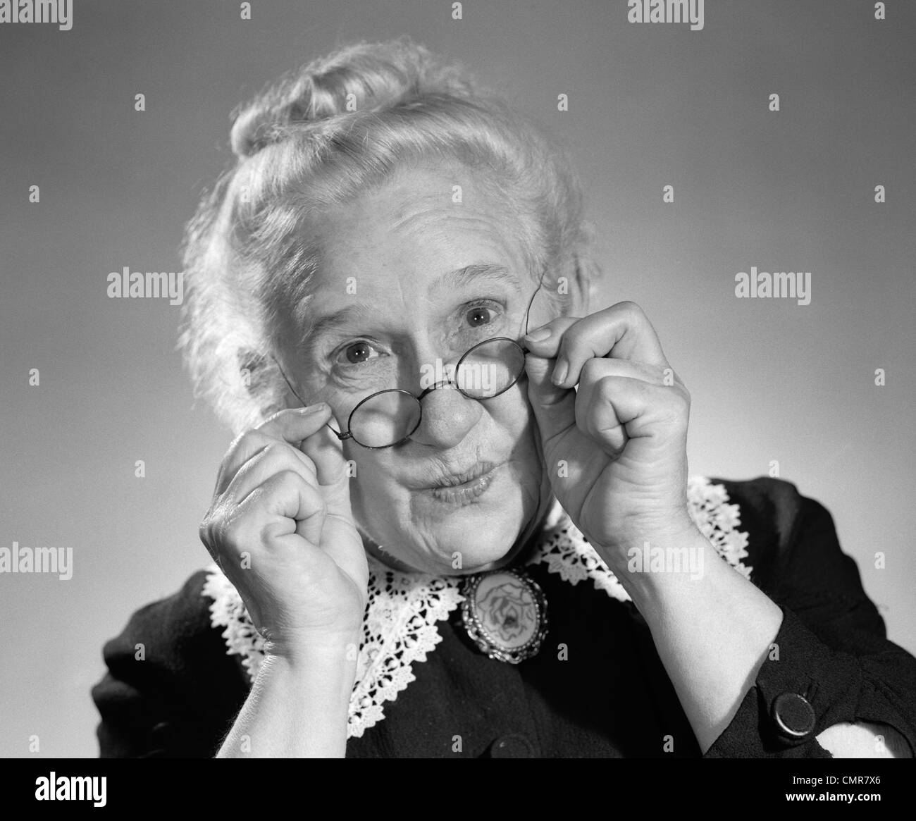 1950s PORTRAIT OF SMILING OLD LADY HOLDING HER ANTIQUE WIRE FRAME ...