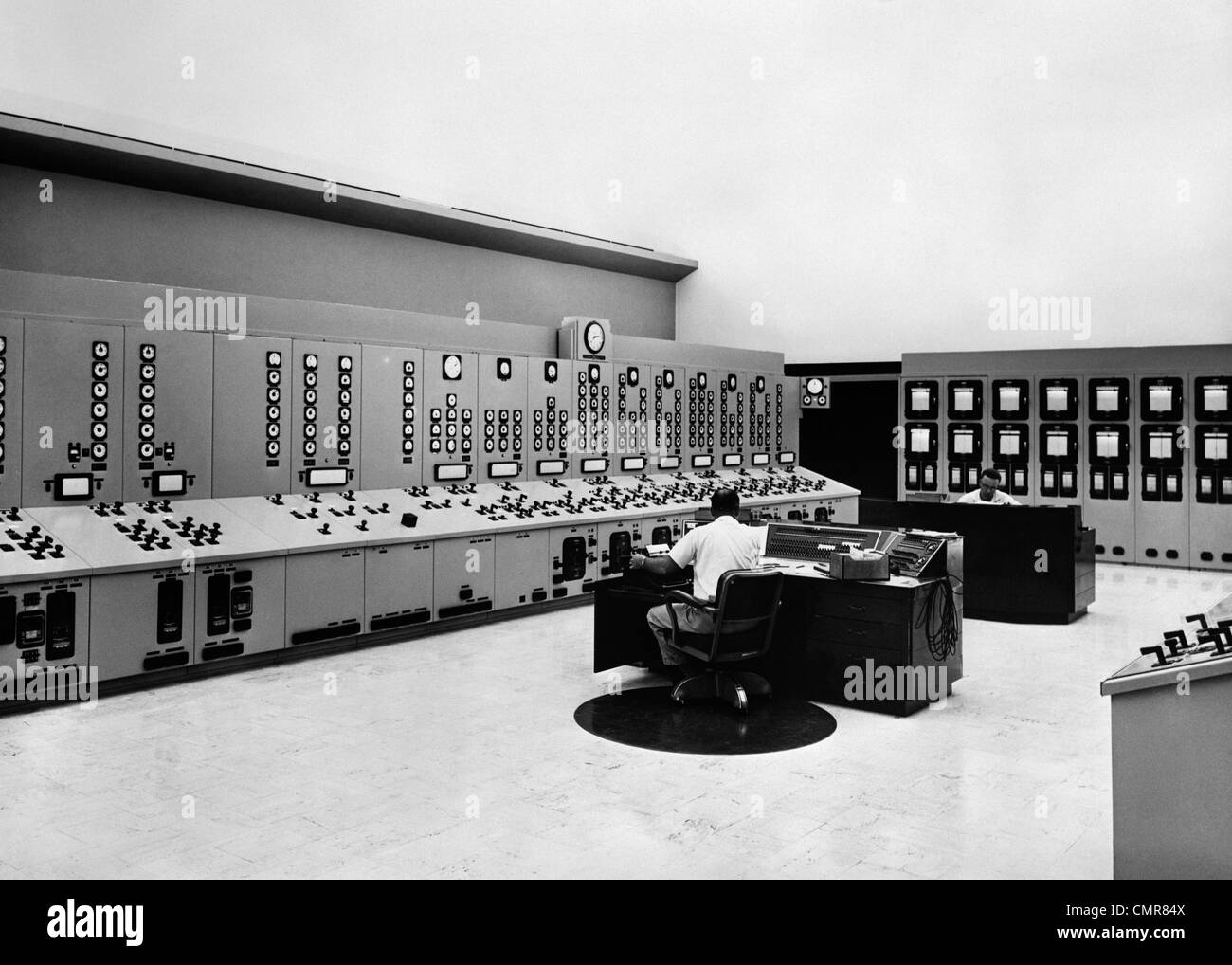 1950s 1960s CONTROL ROOM OF POWERHOUSE OF HYDROELECTRIC GENERATING DAM - Stock Image